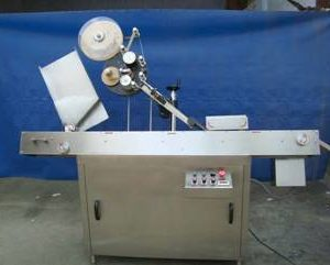 Automatic Horizontal Top Sticker Labelling Machine Model No. SBHSL - 150 for Syringe