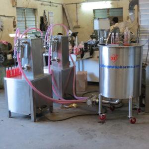 Two Head Semi Automatic Volumetric liquid Filling Machine