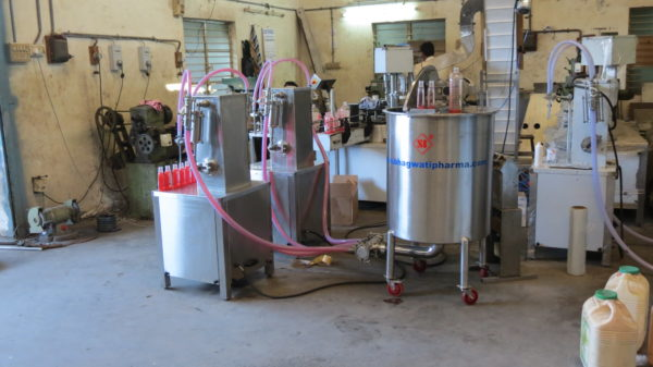 Two Head Semi Automatic Volumetric liquid Filling Machine
