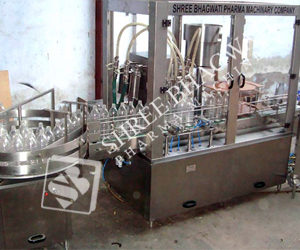 Automatic Monoblock Linear Twenty Four Head Piston Filling cum Single Head ROPP Cap Sealing Machine up to 4000 to 10000 Bottles Per Hour Output