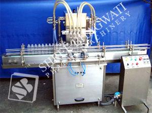 Automatic Four Head Volumetric Liquid Filling Machine Model No. SBLF – 100 GMP Model