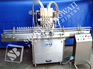 Automatic Four Head Volumetric Liquid Filling Machine Model No. SBLF – 100 GMP Model